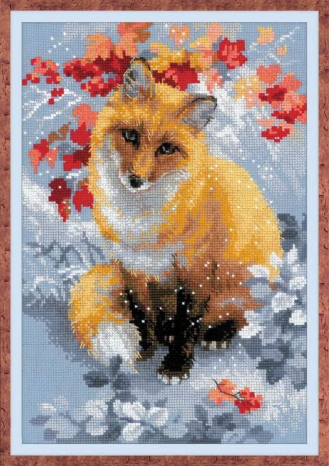 Un renard parmi les feuilles à broder au point de croix compté.